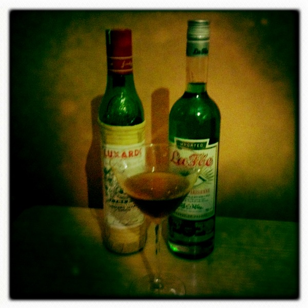 Maraschino and absinthe behind a McKinley's Delight cocktail